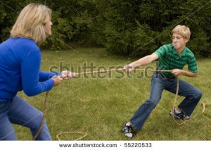 stock-photo-mother-and-son-tug-of-war-55220533
